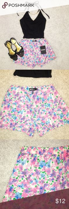 NWT Missguided Floral High Waisted Shorts NWT Miss Guided Floral High Waisted Shorts. Size 6. But fits 2-4. Elastic waist. Like new condition. Bundle two or more items and get 20% off your order! Missguided Shorts