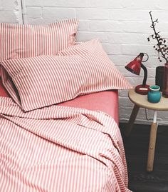 Love Ticking Stripes On The Bed. Remodelista