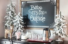 When you opt for three teeny trees instead of one big one, you can sneak an abundance of holiday decor into a small space, like this dining room sideboard turned into a hot chocolate station. Christmas Baby Shower, Baby Shower Winter, Christmas Brunch, Baby Winter, Winter Christmas, All Things Christmas, Baby Boy Shower, Holiday Fun, Christmas Holidays