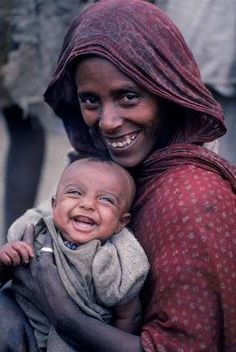 Africa | Islamic Amhara woman and baby in their village of Geech in the Simien Mountains in northern Ethiopia. These people are weavers and live high in the mountains | ©Robert Caputo