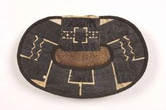 Mangbetu Ornament, negbe, (pl. egbe) Uele region, northeast DR Congo Plant fibers (including raffia, plantain leaves) Embroidery and appliqu...