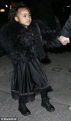 Mini fashionista!Kim's Kardashian's daughter North, aged four, looked especially chic in ...