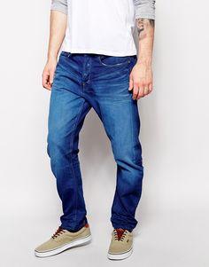 Jeans von G-Star aus reinem Baumwoll-Jeansstoff mittlere Waschung verdeckter Schlitz mit Knopfverschluss klassischer Stil mit fünf Taschen normale Bundhöhe Karottenschnitt