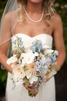 Bride to Be Reading ~ Can't get enough of this light blue and peach bouquet! // photo by http://www.stephanieasmith.com, via http://theeverylastdetail.com/beach-chic-light-blue-peach-wedding/