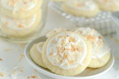 These Coconut Meltaway Cookies are crazy soft and literally melt in your mouth with their simple soft shortbread base. They are topped with a little coconut milk frosting and toasted coconut. Köstliche Desserts, Delicious Desserts, Dessert Recipes, Sweet Cookies, Yummy Cookies, Sweet Treats, Cookies Soft, Fancy Cookies, Cookies