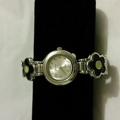 Multi color watch Multi-colored flower bangle watch. Only worn a couple of times.  Needs new battery. Accessories Watches