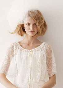 Melissa Sweet illusion lace cape.  Stunning illusion cape features delicate lace detail.  Available in Ivory.  Fully lined. Dry clean.