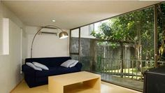 Image 9 of 16 from gallery of Wisnu & Ndari House / djuhara + djuhara. Photograph by djuhara + djuhara Steel House, Main Entrance, Real Estate Houses, Yard Landscaping, Living Room Interior, Second Floor, Ground Floor, My House, Living Spaces