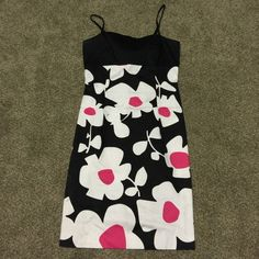 Black and pink flower dress Good condition. Black white and pink. Spaghetti straps. Back zippers and has a tie for a mini open back London Times Dresses Mini