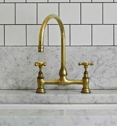 The brass Deck-Mounted Faucet with Gooseneck Spout by family-owned UK company Barber Wilson is $716 at Quality Bath. From Trade Secrets: Notting Hill by Charles Mellersh.