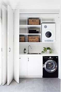 """**Downsize your laundry.** Slotting your washing machine and dryer into a cupboard enables you to have a laundry in high-traffic areas such the kitchen or bathroom, which can also be shut it away. Also utilise any spare surface area for storage by building in shelves, shacks and hooks. See more of this [Melbourne home](http://www.homestolove.com.au/interior-designer-terri-shannon-lights-up-melbourne-home-2854