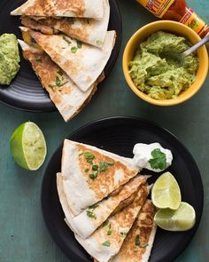 These quesadillas are stuffed with spinach refried beans and cheese. Also: Guacamole (duh). Get the recipe via the link in our profile. (: @siftandwhisk)