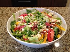 Delicious and healthy spinach and mango summer salad, perfect for barbeques!
