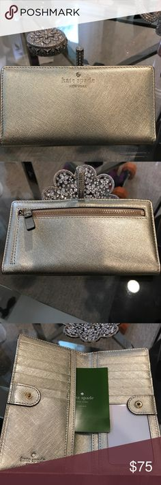 ♠️💕Kate Spade Metallic Gold Wallet♠️💕 ♠️💕This leather wallet is stunning!! Can be held alone it's so pretty. It glimmers in the light. Never been used. No tags but has the card inside. Beautiful gift for yourself!! ♠️💕 Kate Spade Bags Wallets
