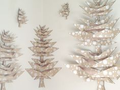 Inspired by Japanese origami and pop-up paper art, the Pop Tree aims to be simple and beautiful.  Made of silk-screened recycled chipboard and birch plywood, the unfolded Pop Tree brings life to a flat, inconspicuous object.