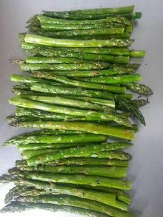 Sauté chopped asparagus with sesame oil