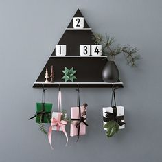 The advent prepping continues 👆 Have you seen our new Triangular Paper Shelf? Dressed up as advent calendar with four magnetic tool hooks 🎁🎁🎁🎁. The hooks are available as extra accessories for all our shelves 👍 Christmas Decorations, Christmas Ornaments, Holiday Decor, Diy Weihnachten, Lettering Design, Design Letters, Mugs Set, Danish Design, Candle Making