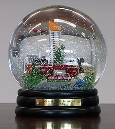 So, I had just started a new board and was trolling Pinterest for pictures of Snow Globes, and I ran across this piece of Wichita memorabilia. I immediately recognized the distinctive shape of the Epic Center in downtown Wichita, THEN I saw the Wichita Art Museum plaque. Pretty cool.