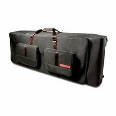 """GigSkinz 61 Key Keyboard Bag by Gig Skinz. $121.99. BGK5 Features: -Sleek urban look that is sure to turn heads. -Solid black with touches of red accents. -Tough water repellent nylon fabric. -Padded interior, pockets and shoulder strap. -Adjustable internal dividers. -Industrial zippers and rugged metal hardware. -Textured skid proof bottom. -Dimensions: 9"""" H x 43"""" W x 14"""" D.. Save 51%!"""