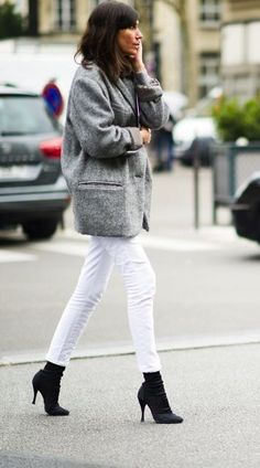 Black booties, black socks, white jeans