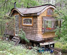 LOVE this little gypsy wagon house (it has a cottage feel to it...best of BOTH