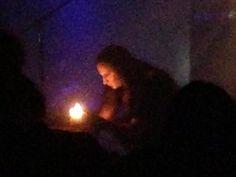 A closer shot of John Haughm lighting up incense.