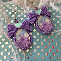 Hey, I found this really awesome Etsy listing at https://www.etsy.com/listing/184764290/purrrple-cats-small-cameo-earrings