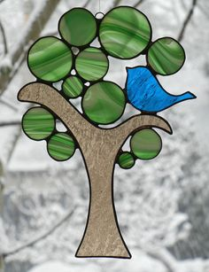 Stained Glass Suncatcher Love Bird in a Green by ShatteredbyLight. , via Etsy.
