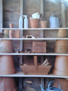 Garden shed shelves made using pots and planks