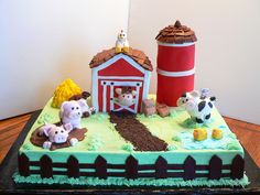 barnyard birthday - This is my first barnyard cake for a little boys first birthday. Thanks to all the inspiring barnyard cakes on CC!! It took alot longer than I thought it would but I had fun putting it all together. :D The barn and the silo are white cake and the 1/2 sheet is choc with ding dong filling. TFL!