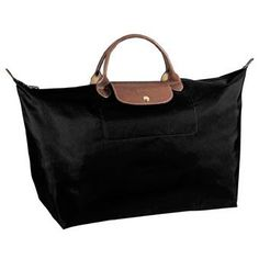 Longchamp Bag! Best Travel bag... it folds up for storage and is the perfect size for all your travel needs, and to top it off it's super chic!