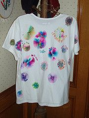 Sharpie Pen Tie-Dye•colored Sharpie pens (permanent ink pens)  •rubbing alcohol (e.g., 70% or 90% isopropyl alcohol)  •white or light-colored cotton t-shirt  •plastic cup
