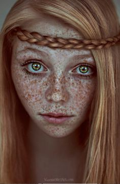 More like a strawberry redhead & freckles, lotsa freckles!  Oh, and green eyes too.  Beautiful.