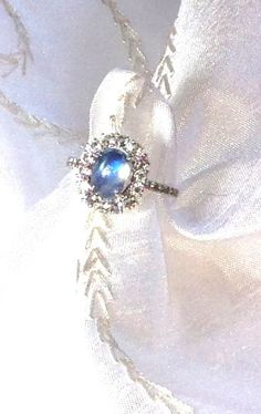 Rainbow Moonstone Halo Ring or Engagement Ring by NorthCoastCottage Jewelry Design & Vintage Treasures on Etsy.com, $399. #handmade #jewelry #bridal www.etsy.com/shop/NorthCoastCottage