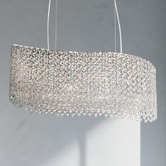 Embellished with crystals in a stunning wave pattern., this contemporary pendant chandelier will add drama to your entryway or dining room.