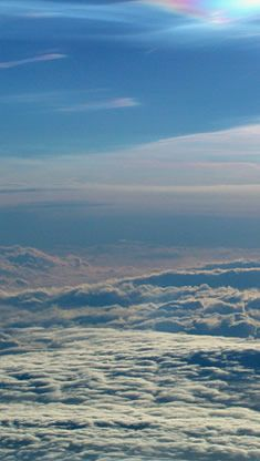 View across the tropopause from a high flying research aircraft. Below are familiar tropospheric clouds, above are rare nacreous clouds formed at the low temperatures of the tropopause and lower stratosphere.