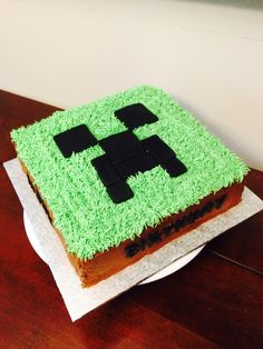 Minecraft Creeper Cake. Marble white and chocolate cake, chocolate and vanilla buttercream, and fondant accents.