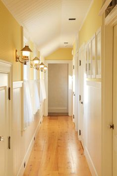 Hallway Decorating Ideas ~ cottage style hall with bead board and lantern sconces
