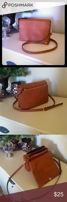 """🎉HP 12/10/16 🎉 Leather crossbody bag This was in a stitch fix shipment.  Only used a few times.  Like new just too small for my taste and all my """"necessities"""".  Last picture is just to show size and strap length which is adjustable.  The one being sold is brown.  *no trades* Bags Crossbody Bags"""