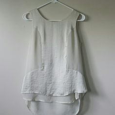 Cream Tank Elegant cream tank with a high-low hemline. The longest back layer is a very gauzy material. Very pretty, in really great condition: no stains or tears. Worn fewer than 5 times. Size mall, but could fit a medium. Tops