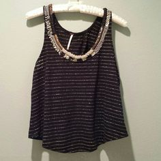 Free people embellishmed tank Airy tank with gold thread, silver, gold , bronze and tan beading. Butterfly open back. Free People Tops Tank Tops