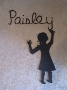 Little girl writing her name on wall (Paisley)... for baby room...love this name but Ian just shot it down...lol