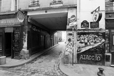 A tucked away bar awaits its first customers of the day in the Rue de Lappe