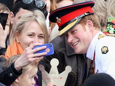 Star Tracks: Tuesday, May 20, 2014 | A ROYAL SNAP | Now that's a selfie for the books! Prince Harry grants a fan the ultimate photo op – complete with an adorable paper crown! – in Tallinn, Estonia's Freedom Square on Friday.
