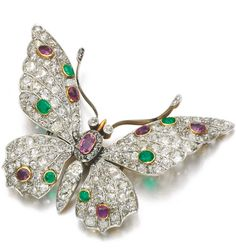 GEM SET AND DIAMOND BROOCH, LATE 19TH CENTURY Designed as a butterfly, set with circular-cut and oval rubies and emeralds and circular- and single-cut diamonds.