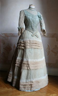 1886 - Summer dress, perhaps from vacation in two pieces (bodice and skirt) ecru linen on blue background.