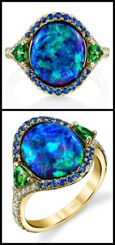 http://diamondsinthelibrary.com/award-winning-omi-prive-black-opal-ring/ The award-winning Lighting Ridge black opal ring by Omi Privé, with diamonds, sapphires, and tsavorite garnet; top and side view