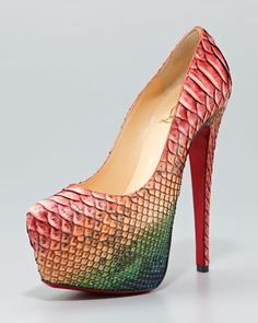 Not a fan of animal prints but.....these are cute! Daffodile Python Platform Pump by Christian Louboutin at Neiman Marcus.