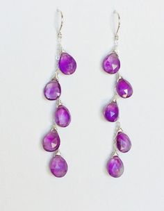 AAA genuine faceted pearl shape amethyst briolette cascade down delicate sterling silver cable chain. Handmade sterling silver French ear wire. Earring is about 2.5 inches. Amethyst is the birthstone