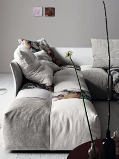 Love the patchwork upholstery. Modular upholstered sofa PIXEL by Saba Italia.